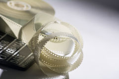 Closeup of a spool of film into a movie and slapstick Royalty Free Stock Photography