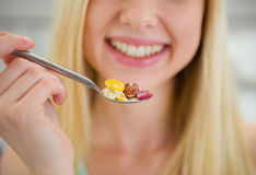 Closeup on spoon with flakes in hand of girl Royalty Free Stock Photography