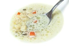 Closeup of spoon in soup Royalty Free Stock Photos