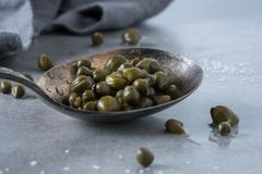 A closeup of a spoonful of capers Royalty Free Stock Photography