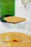 Closeup of spoonful cheddar cheese soup Stock Image