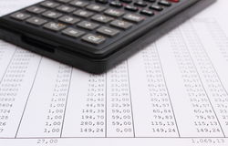 Closeup of spreadsheet with calculator Stock Photography