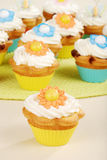 Closeup springtime flower cupcake. With more in the background Stock Photos