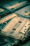 Stack of audio cassettes on grey table. Closeup of stack of audio cassettes on grey table royalty free stock image