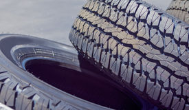 Closeup of Stack of Brand New Automobile Black Tyres with Number Royalty Free Stock Photography