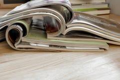 Closeup Stack of colorful magazines. Closeup Stack of colorful magazines on wooden table Stock Image