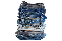 Stack of folded blue jeans pants, dark blue denim trousers showi Stock Photos