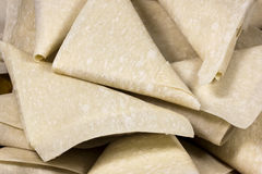 Closeup Stack of Freshly Folded Uncooked Samoosas Stock Images