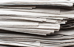 Closeup stack of newspapers Stock Photography