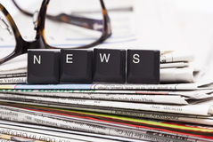 Closeup stack of newspapers Royalty Free Stock Photos
