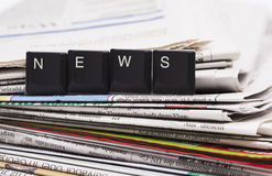 Closeup stack of newspapers Royalty Free Stock Photography