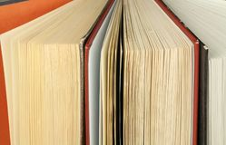 Closeup of stack of old ajar corner books Royalty Free Stock Photos