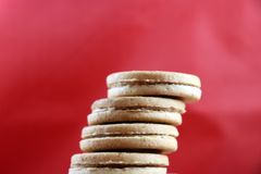 Closeup of stacked peanut butter cookies with red background stock images