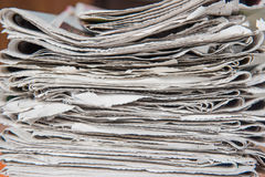 Closeup Stacked and piled up newspapers for  background Stock Photography
