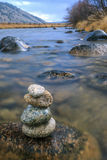 Closeup of stacked rocks in river. Royalty Free Stock Photography