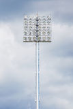 Closeup stadium light with black cloudy sky before raining. Royalty Free Stock Photography