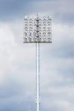 Closeup stadium light with black cloudy sky before raining. Royalty Free Stock Photography