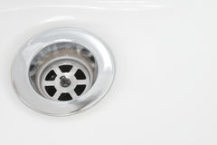 Closeup of stainless steel drain Royalty Free Stock Image