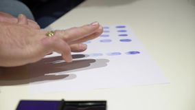 Closeup of fingerprint on paper. Closeup of stamping fingerprint on paper stock video