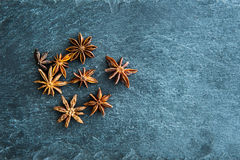 Closeup on star anise on stone substrate Royalty Free Stock Images