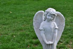 Closeup Statue of a Female Child Angel Statue in a Cemetery royalty free stock photo