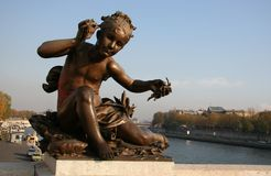 Closeup of a statue on the Pont Alexandre III. Paris, France Royalty Free Stock Image