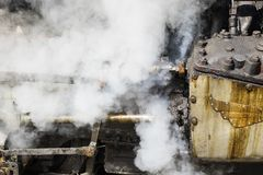 Closeup of the steam cylinder with valves of the famous Darjeeling toy train. Closeup of the steam cylinder with valves of the famous Darjeeling steam train in Royalty Free Stock Image