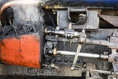 Closeup of the steam cylinder with valves of the famous Darjeeling toy train. Closeup of the steam cylinder with valves of the famous Darjeeling steam train in Royalty Free Stock Photo