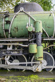 Closeup of steam train wheels. A closeup of an old steam locomotive wheels Royalty Free Stock Photography