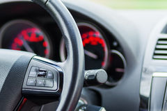 Closeup of a steering wheel and dashboard of a car. Closeup picture of a steering wheel and dashboard of a car Royalty Free Stock Photo