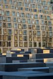 Closeup of the steles of the Holocaust memorial in Berlin in the. Evening sun with the back of the DZ bank in the background, Nahaufnahme der Stelen des Royalty Free Stock Photography