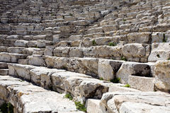 Closeup of steps of ancient Greek amphitheatre. Closeup of white steps of ancient Greek amphitheatre, Segesta village, Sicily, Italy Royalty Free Stock Photo