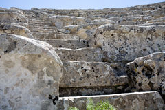 Closeup of steps of ancient Greek amphitheatre. Closeup of white steps of ancient Greek amphitheatre, Segesta village, Sicily, Italy Royalty Free Stock Photos