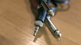 Closeup of stereo audio connectors plug  on wooden background Royalty Free Stock Photography