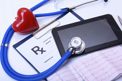 Closeup of stethoscope,red heart on a rx prescription and phone Stock Images