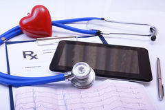 Closeup of stethoscope on a rx prescription and phone.  Stock Photos