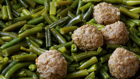 Closeup stewed noisettes with french bean Stock Images