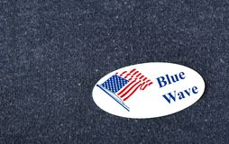 Blue Wave Sticker. Closeup of a sticker with an American flag and the words `Blue Wave,` suggesting the Democratic party will gain seats in congress, placed on a Stock Photography