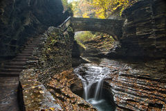 Closeup of a stone bridge over Rainbow Falls in Watkins Glen State Park Stock Image