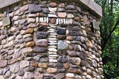 Saint Anne`s Shrine, Isle La Motte, an island in Lake Champlain, Grand Island County, Vermont, United States, US. Closeup of stone cross on Saint Anne`s gold stock image