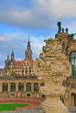 Closeup stone figure and Residenzschloss (city hall) on the back Stock Photography
