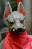Closeup of a stone fox statue. Royalty Free Stock Photo
