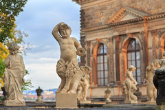 Closeup stone statue of child faunus at Zwinger palace in Dresde Royalty Free Stock Photography