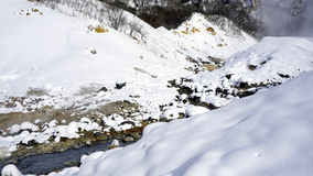 Closeup stone and stream in the mist Noboribetsu onsen Stock Photography