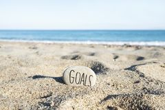 Text goals in a stone on the beach royalty free stock photos