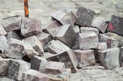 Stoned cobbles for road paving construction. Closeup of stoned cobbles for road paving construction royalty free stock image