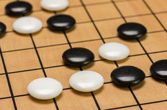 Closeup of stones on a Go board Stock Image