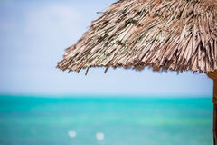 Closeup straw beach umbrella on tropics Royalty Free Stock Photos