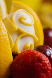 Closeup of strawberry covered with a color chocolate Royalty Free Stock Photography