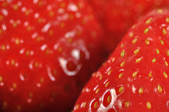 Closeup strawberry detail. Extremply closeup strawberry detail. Red strawberry background Royalty Free Stock Photo